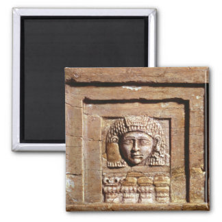 Relief depicting a woman at a window fridge magnet