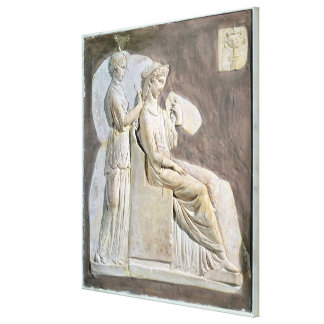 Relief depicting a woman at her toile canvas print
