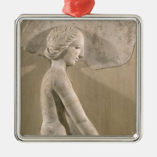 Relief depicting a woman in profile christmas tree ornament