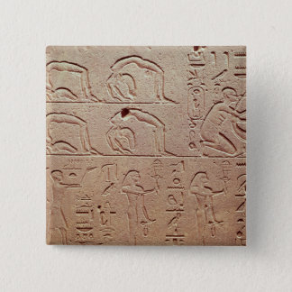 Relief depicting acrobats and a harpist button