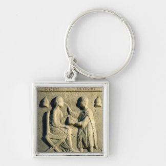 Relief depicting an oculist examining a patient key chains