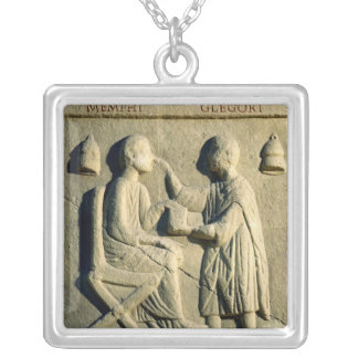 Relief depicting an oculist examining a patient silver plated necklace