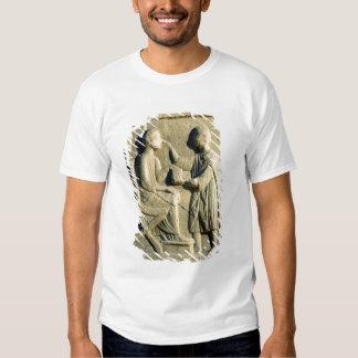 Relief depicting an oculist examining a patient t shirt