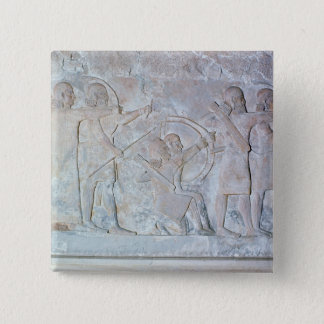 Relief depicting archers button