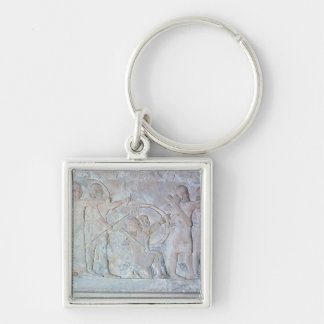 Relief depicting archers keychain