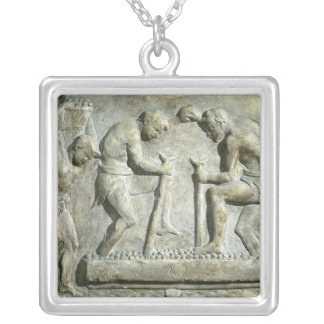 Relief depicting pavers silver plated necklace