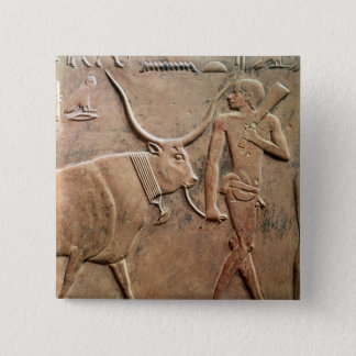 Relief depicting peasant leading cow to button