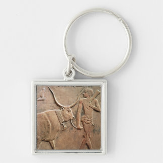 Relief depicting peasant leading cow to keychain