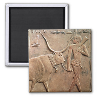 Relief depicting peasant leading cow to magnet