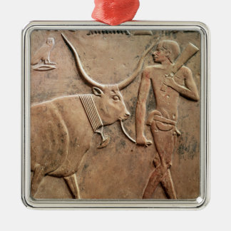 Relief depicting peasant leading cow to metal ornament