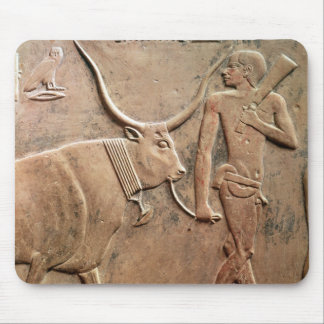 Relief depicting peasant leading cow to mouse pad