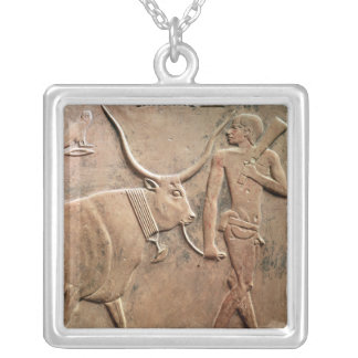Relief depicting peasant leading cow to silver plated necklace