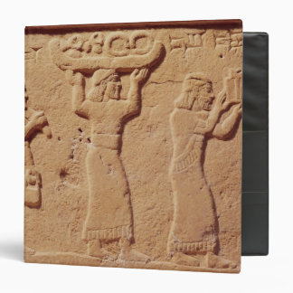 Relief depicting porters laden with gifts binder