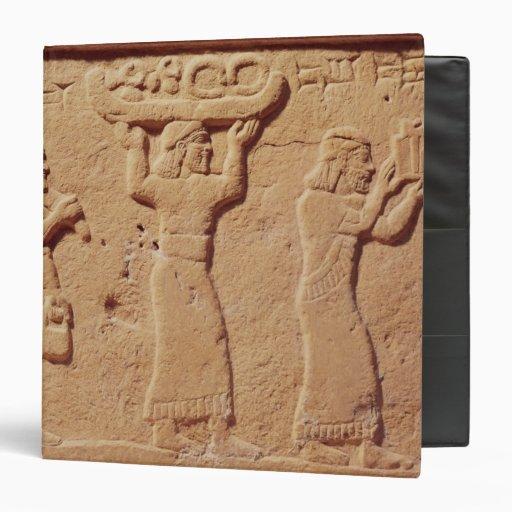 Relief depicting porters laden with gifts vinyl binder