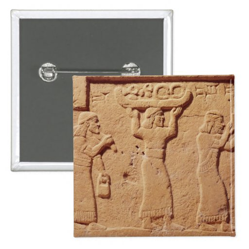 Relief depicting porters laden with gifts button