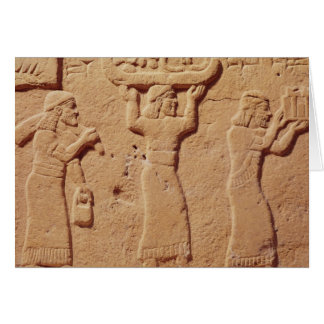 Relief depicting porters laden with gifts card