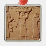 Relief depicting porters laden with gifts christmas ornament