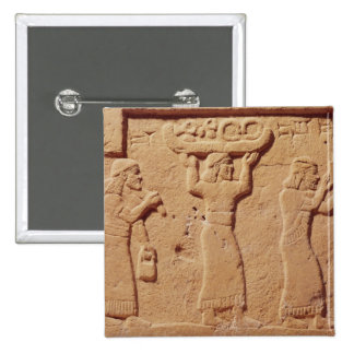 Relief depicting porters laden with gifts pinback button