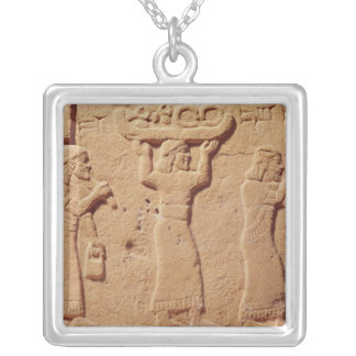 Relief depicting porters laden with gifts silver plated necklace