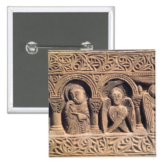 Relief depicting saints with a seraph pinback button