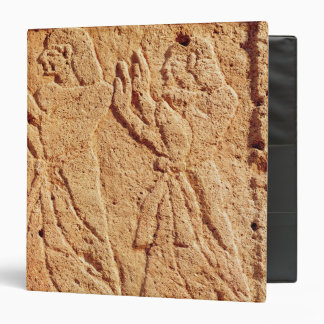 Relief depicting servant paying homage to the binder
