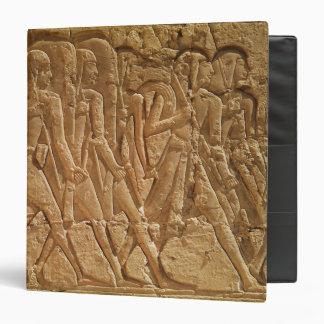 Relief depicting servants carrying rope binder