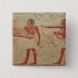 Relief depicting servants pinback button