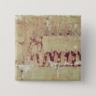 Relief depicting soldiers button