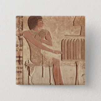 Relief depicting the deceased seated pinback button