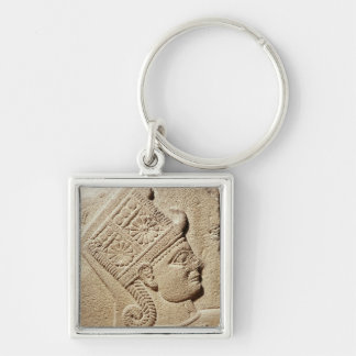 Relief depicting the head of a young prince keychain