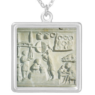 Relief depicting the interior of a forge silver plated necklace