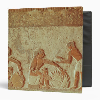 Relief depicting the making and baking of bread binder