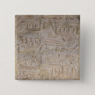 Relief depicting the unloading of wood pinback button
