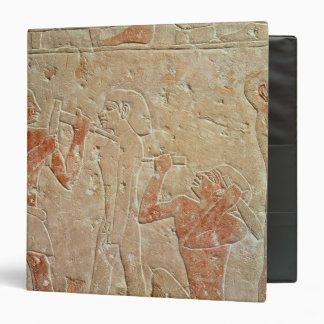 Relief depicting two sculptors carving a 3 ring binder