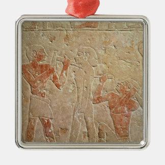 Relief depicting two sculptors carving a metal ornament