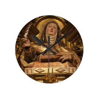 Religious art representing Santa Teresa Round Clock