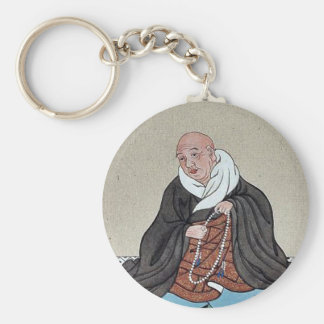 Religious figure holding a loop of prayer beads keychain
