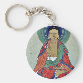 Religious figure sitting on a lotus with blue halo key chain