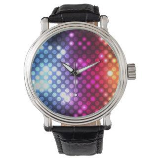 Reloj abstracto de los puntos ligeros