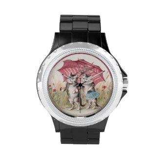 Reloj adorable con los gatos antropomorfos