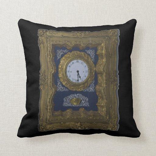 reloj almohadas