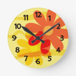 Reloj amarillo y anaranjado de la flor
