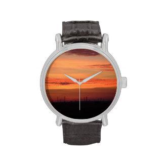 Reloj anaranjado de la puesta del sol
