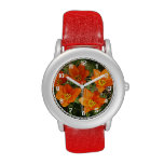 Reloj anaranjado de los tulipanes