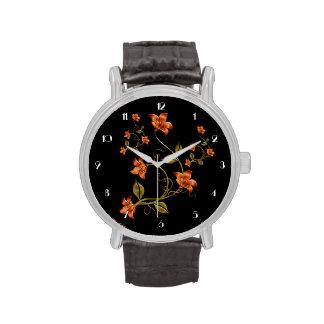 Reloj anaranjado del negro del estampado de flores