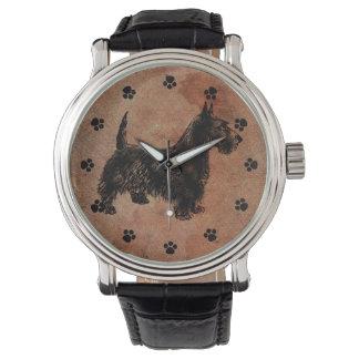 Reloj antiguo del perro del escocés de la mirada