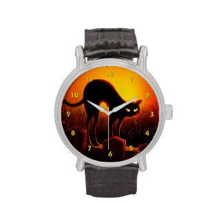 Reloj asustadizo de los ojos del gato negro de Hal