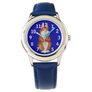reloj azul con el conejito y las flores marrones