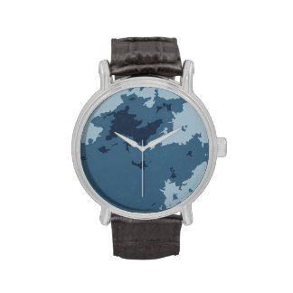 Reloj azul del arte abstracto
