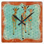 Reloj azul y ambarino de las jirafas